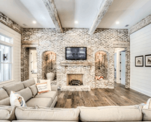 wood beams, rustic living room, farmhouse living room, white living room, neutral room, wood beams, white brick, wood beam fireplace