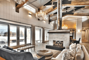 wood beams, rustic living room, farmhouse living room, white living room, neutral room, farmhouse chandelier
