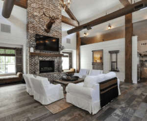 wood beams, rustic living room, farmhouse living room, white living room, neutral room, white brick fireplace