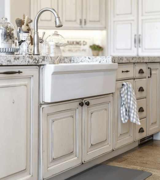 I love this farmhouse sink and the timeless cabinets. The neutral white is classy and beautiful. Seriously gorgeous! You will love all of these kitchens so much. The perfect touch of farmhouse, french country and rustic.