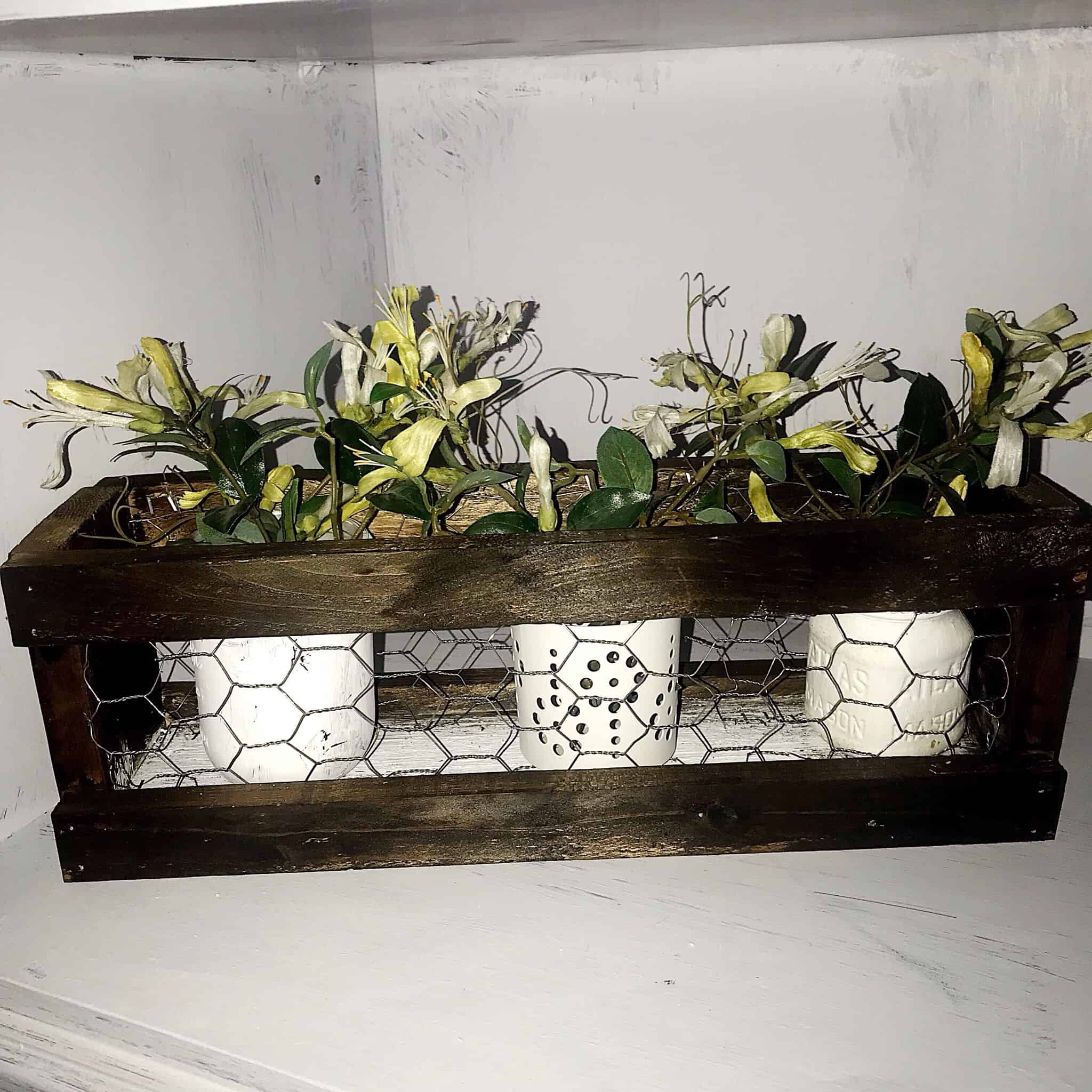 Close up of diy chicken wire wood planter