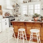 Shiplap kitchen with open shelves and wood island.